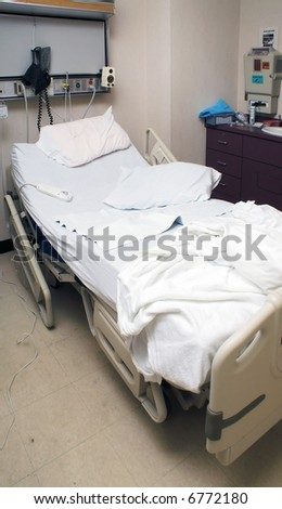A medical patient\'s bed in a hospital.