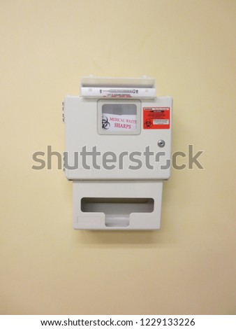 A medical waste bin for sharps such as needles, etc.