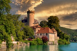 a medieval castle on Annecy lake in Alpes mountains, France