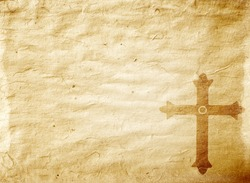 A medieval cross on a worn piece of parchment