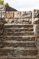 a medieval stone staircase leading up to a castle
