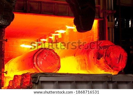A medium shot of two hot molten forged steel rods in a furnace. Stock fotó ©