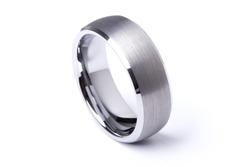 A men plain wedding ring band made out of silver and gold on an isolated white studio background