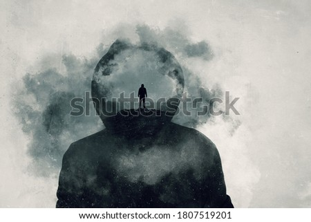 A mental health concept. A mans head covered in clouds. With a double exposure of a mans silhouette over layered on top. Stock photo ©