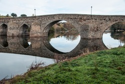 A mesmerizing view of an Old bridge over Tormes river in Barco de Avila, Avila, Spain