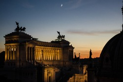 a mesmerizing view of the Vittoriano palace at nighttime in Rome Italy