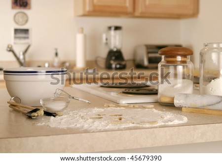 A messy kitchen in the midst of baking cookies