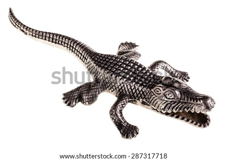 a metal crocodile figurine isolated over a white background