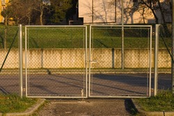 A metal gate with a fence in an urban park (Marche, Italy, Europe)