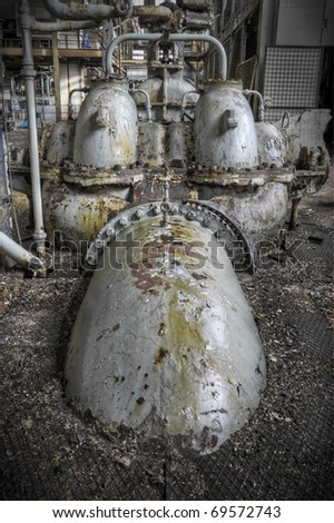 A Metal grungy looking object at an abandoned factory.