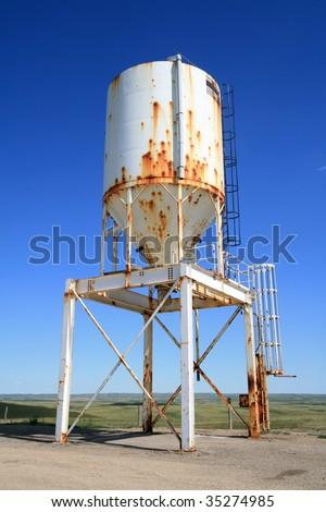 A metal hopper storing road salt at the Old Wives Massacre historic site on highway 2 in Saskatchewan, Canada.