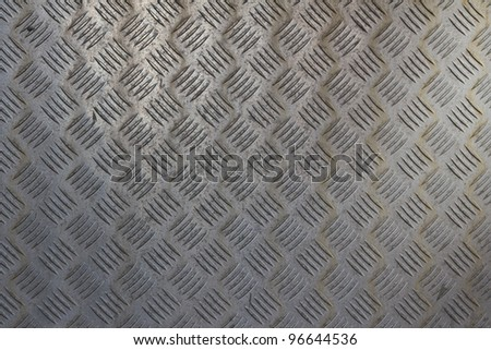 A metal pattern on a heavy machine with a typical structure