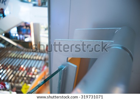 A Metal Railing in department store with backgroud blur.