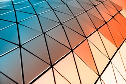 A metal wall made of many triangles. Triangles with sharp corners and gradient transitions.