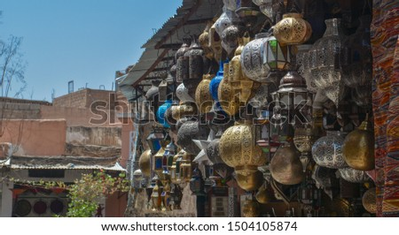 A metalware store at the souk in Marrakesh, Morocco #1504105874
