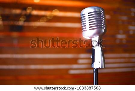 A microphone from a karaoke in a nightclub. Karaoke music background.  #1033887508