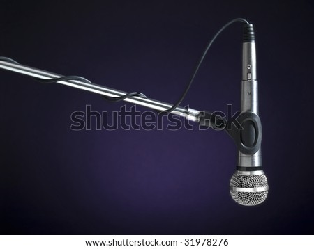 A microphone on a boom over a blue background.