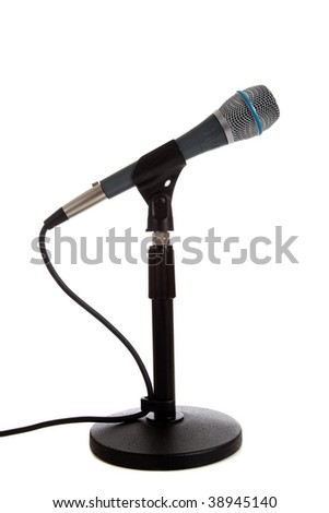 A microphone on a mic stand on a white background - stock photo