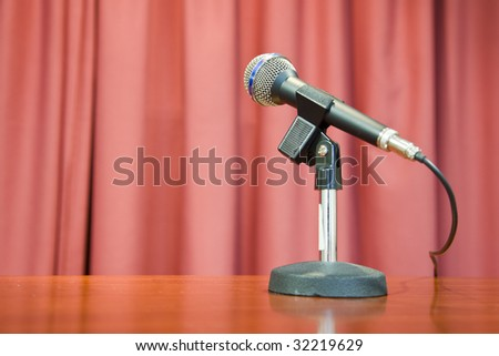 A microphone on a red background
