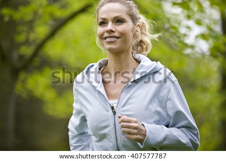 A mid adult woman jogging in the park