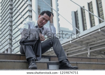 A middle-age businessman has just unemployed due to economic recession make him feeling very stress and depressed. Imply to impact of economic recession concept.