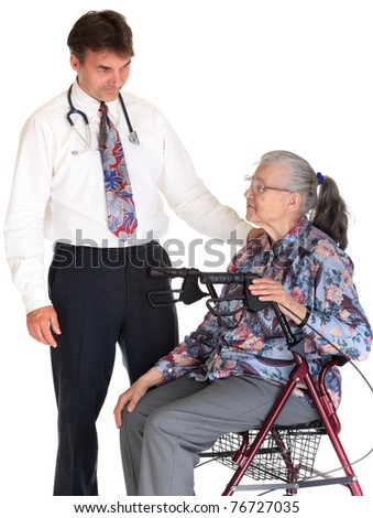 A middle-aged doctor checking a senior woman sitting in her wheelchair, on white studio background.