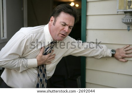 A middle aged man experiencing sudden chest pain.