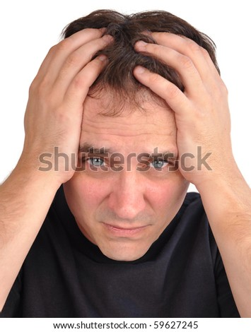 A middle aged man has stress and worry and he is holding his hands on his head, in his hair. Use it for a headache, money trouble or security concept.