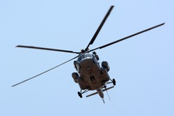 A Mil Mi-17 helicopter flying.