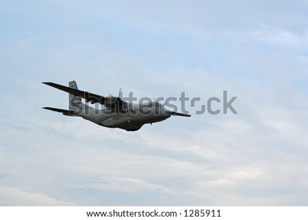 A military aircraft flying low.