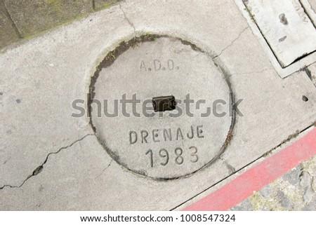 A millstone lines a city sidewalk in AntiguaGuatemala.
