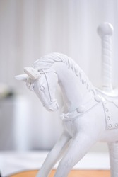 A mini rocking horse toy for decoration or display, a childhood memory, a white horse carousel