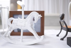 A mini rocking horse toy for decoration or display, a childhood memory, a white horse carousel, nostalgic concept