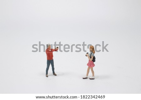 a Miniature figure people , Photographer to take a photo for girl Foto stock ©