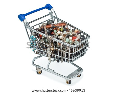 A miniature shopping cart filled with necklaces