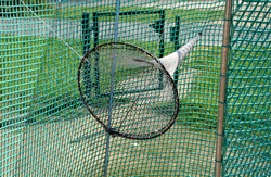 a minigolf course in the park with stainless steel obstacles and a cobweb-shaped ball trap into a funnel-shaped ball to catch the golf balls behind the obstacle. game for points below par or above par
