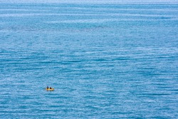 A minimalist photo of a kayak on the open ocean. Photo was taken from the coast of Bermuda.