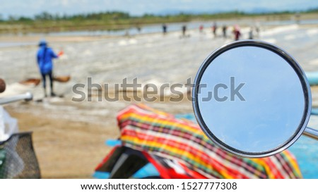 A mirror of moter cycle at salt pan in Samutsongkram province during summer time of Thailand, South East Asia,  Asia.