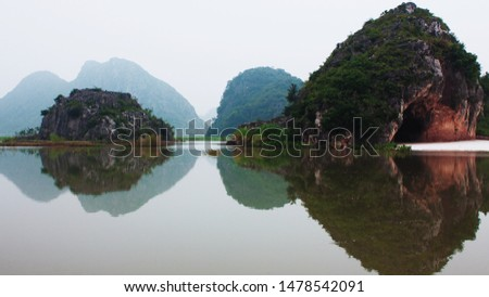 A mirror reflection of the lake #1478542091