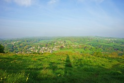 A misty aeriel view of the Cotswold village of Woodchester in spring, Gloucestershire, England, UK