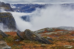 A misty autumn morning in the Norwegian mountains on the way to the Troll's tongue.