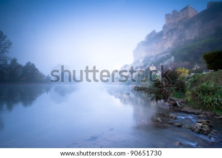 A misty dawn with chateaux Beynac taken from the river Dordogne.