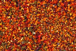 A mixture of different spices close up. Textures of colorful spices and condiments.