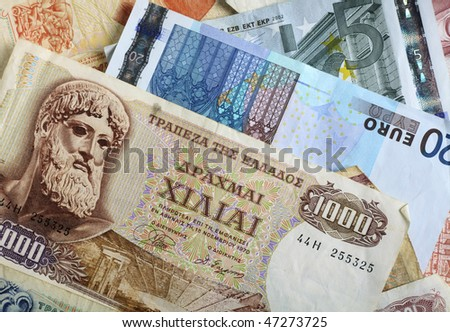 A mixture of old Greek drachma banknotes and euro notes that succeeded them. Greece's adoption of the single currency is now seen as  undermining the euro exchange rate.