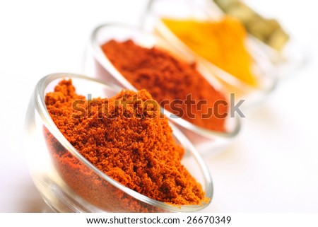 a mixture of spices, turmeric, chilli , cayenne powder and cardamom seedpods