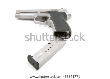 A 9mm handgun magazine being loaded into the pistol