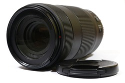 A 70-300mm lens in balck infront of a white background