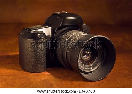 A 35mm SLR camera with standard zoom lens