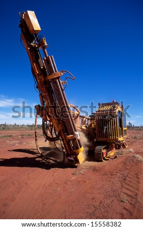 A mobile drilling rig, drilling core samples on a gold mining lease
