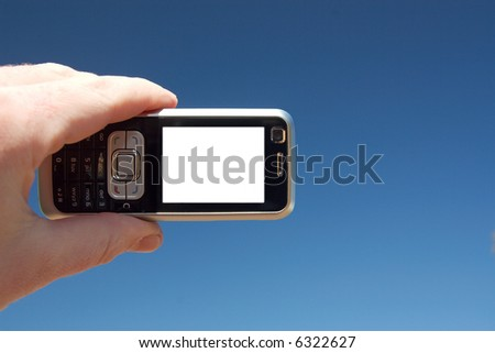 A mobile phone on a blue sky background. Copy-space on the phone screen.